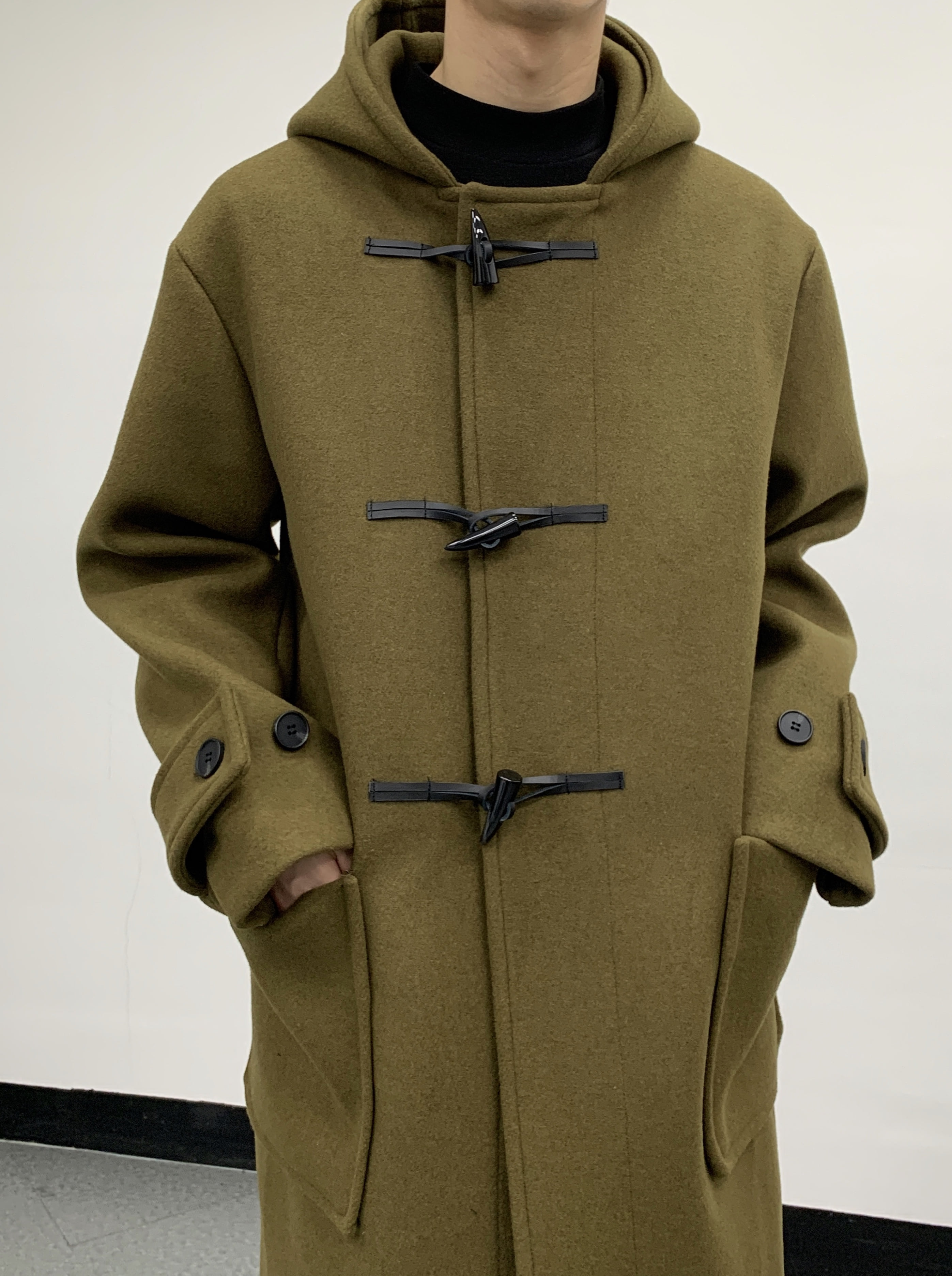 To semiover standard duffle coat